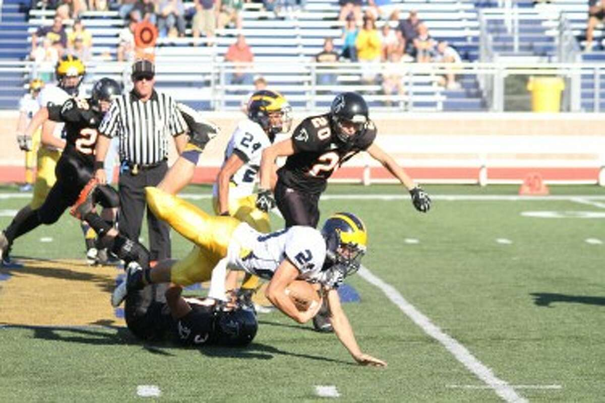 Manistee senior running back Nick Williams is tripped up during the second half of Saturday's loss to Leslie at Grand Haven. (Matt Wenzel/News Advocate)