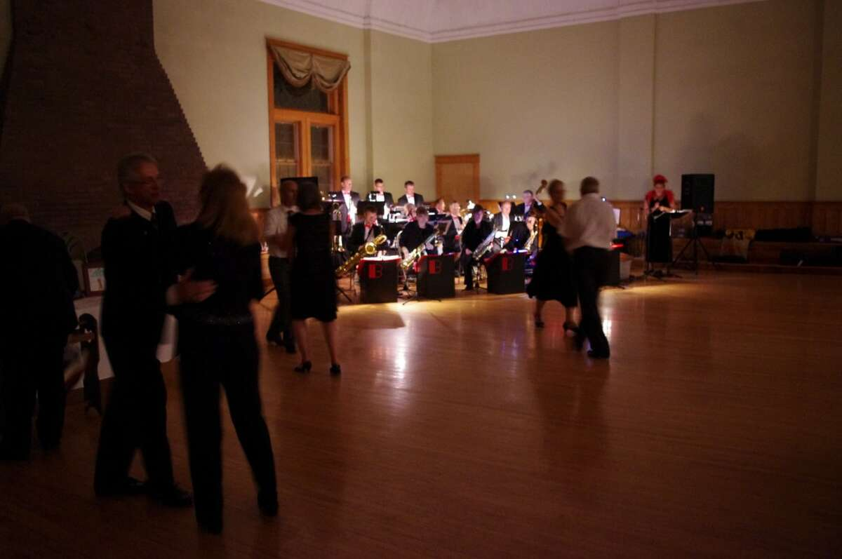 Dancing to the music provided by The Baytones, an 18-piece big band and swing orchestra, went on through the evening Saturday at the fundraiser Swingin' for the Animals held in Rotary Ballroom at the Ramsdell Theatre. (Dave Yarnell/Staff Writer)