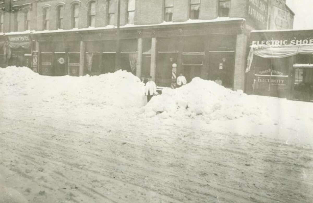 Without the snow removal equipment of today the River Street area looked much more snowbound in this early 1900 picture.