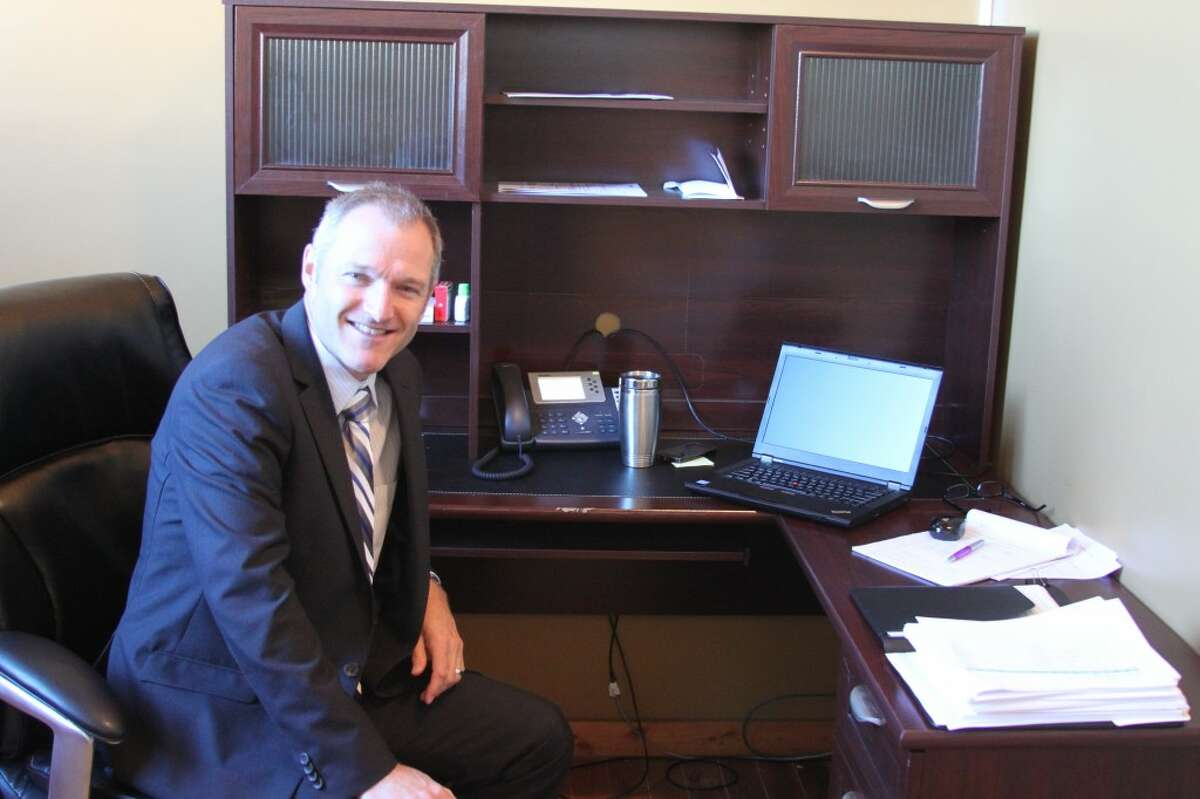 Kendall Schroeder the new head of school for the Great Lakes Virtual Academy sits in his office at the Briny Building. The new online school has 250 students from all over the state enrolled in classes.