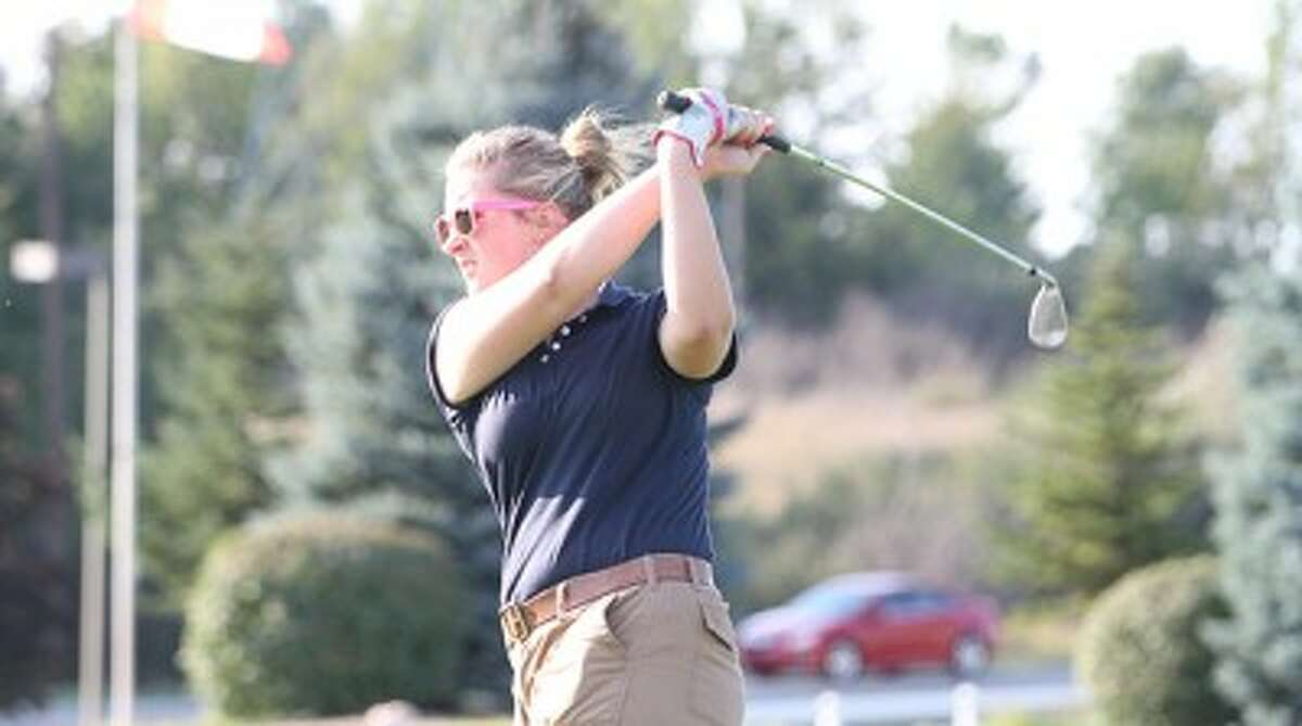 Manistee's Michelle Ball watches her tee shot on No. 9 at Manistee National during Friday's match. (Dylan Savela/News Advocate)