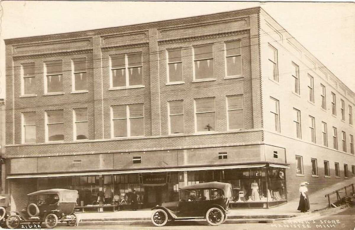 This picture shows the corner of River and Greenbush streets in downtown Manistee as it looked in the early 1920s.