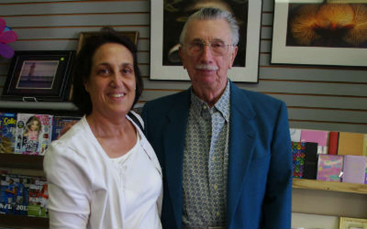 Martha Jennings Wieland of Grand Rapids, stopped to have Vern Tarkowski sign a copy of his book