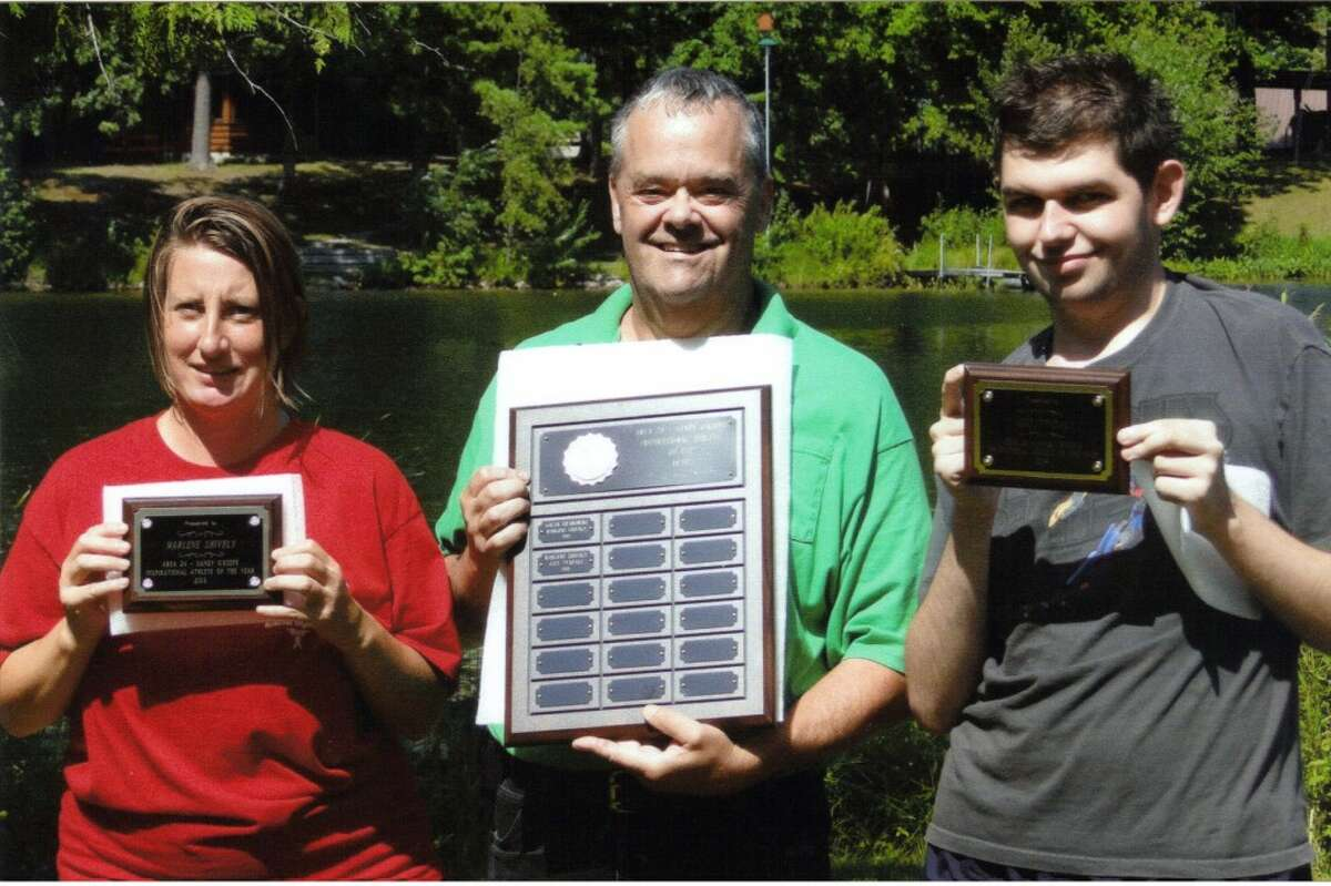 Area 24 Special Olympics Director Jerry Shangle presented certificates to Marlene Shively and Joey Tyndall as Area 24's inspirational athletes of the year at Special Olympics' summer picnic held in Irons. (Courtesy Photo)