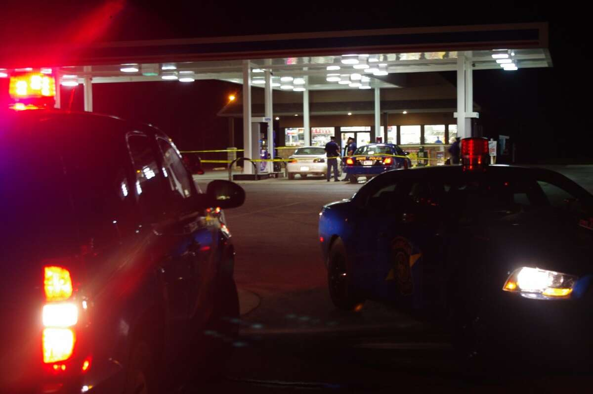 This was the scene at the Dublin Express convenience story Monday after police exchanged gunfire with and arrested two subjects in connection with the shooting of a Michigan State Police officer Monday afternoon in Mason County. The suspects were driving the stolen white 1999 Pontiac Grand Prix. (Dave Yarnell/News Advocate)