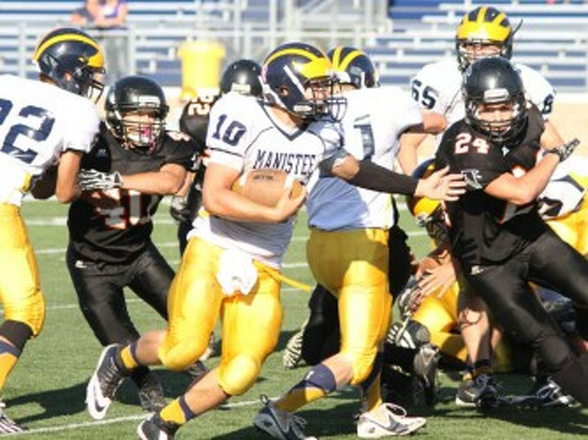 Manistee senior Mason Swidorski (10) picks up yards during Saturday's loss to Leslie at Grand Haven. The Chippewas will travel to face Muskegon Heights Academy on Friday. (Matt Wenzel/News Advocate)