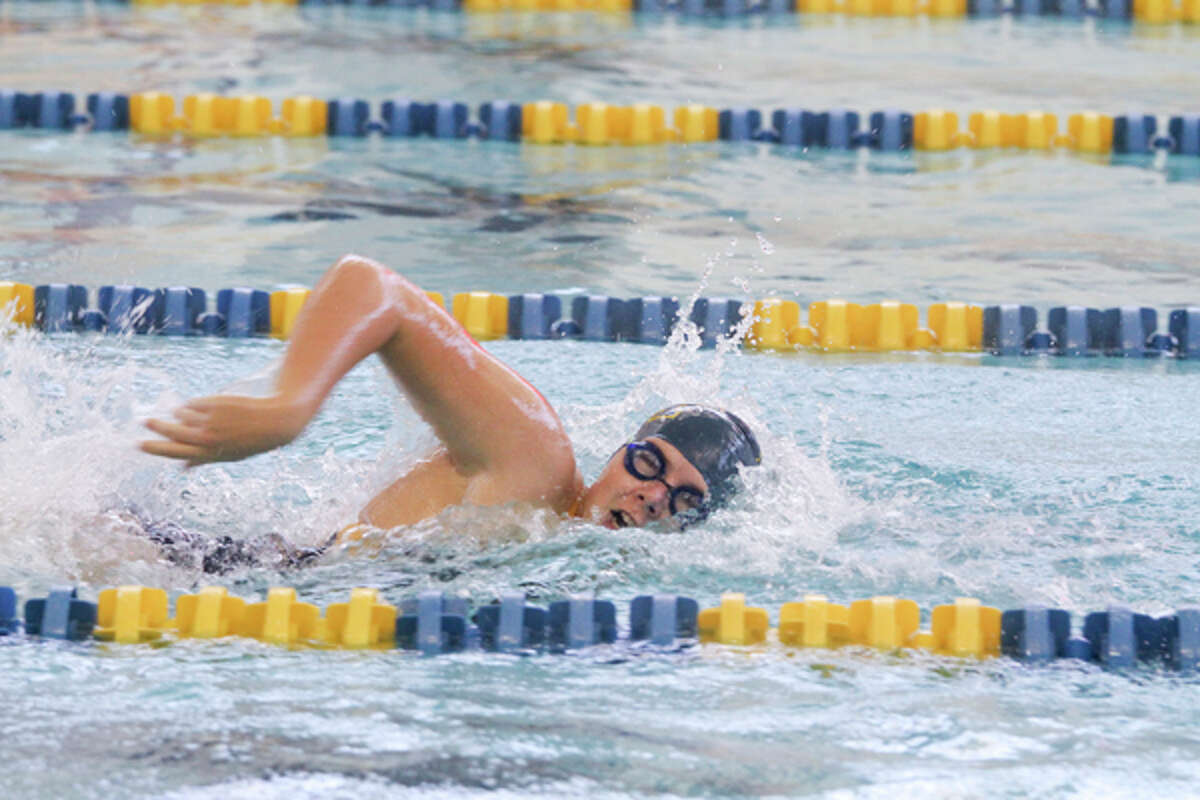 Manistee's Anna Kutschke swims to a state-qualifying time in the 100-yard freestyle during Tuesday's meet. (Dylan Savela/News Advocate)