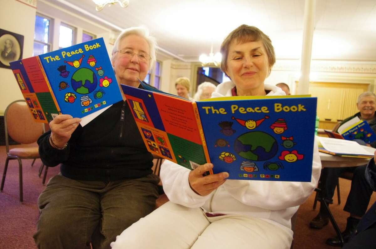 Two of the members of the Manistee Peace Group who will be reading