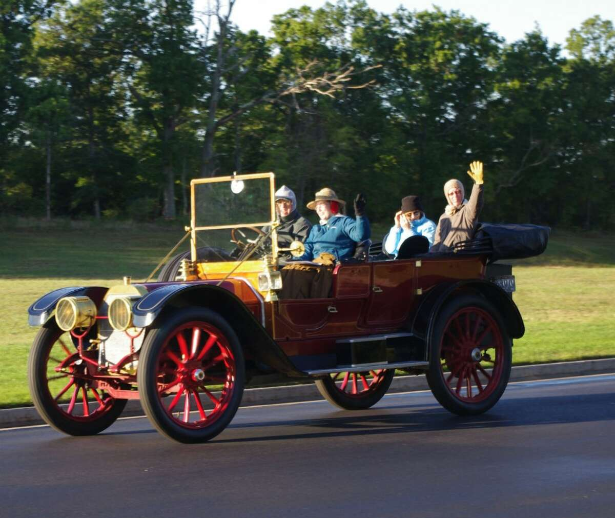 Despite the brisk temperatures, the bundled-up participants in Thursday's Brass and Gas Car Club tour had a good time traveling throughout Manistee County -- and even in to Wexford County. (Dave Yarnell/News Advocate)
