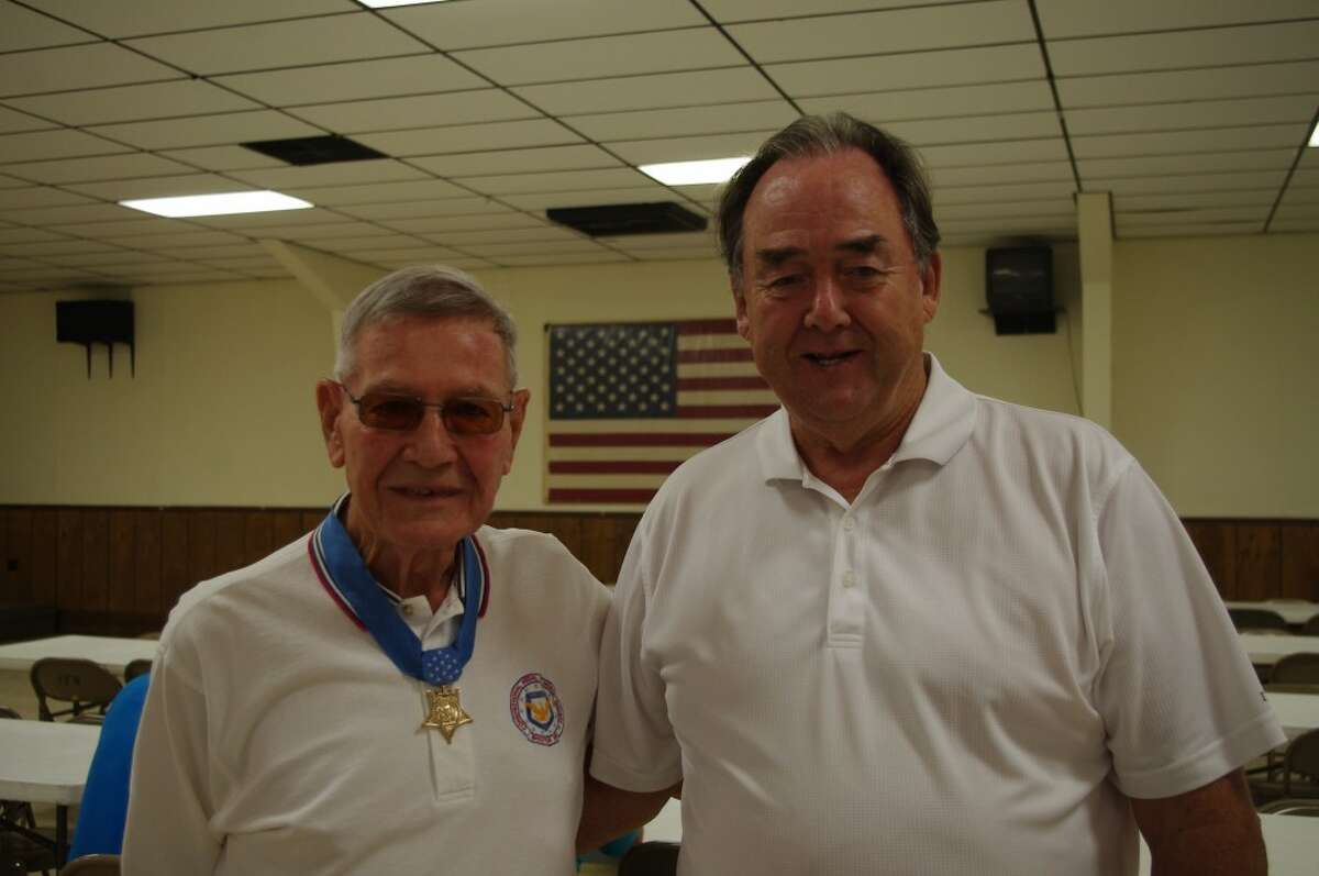 After the golfing, participants in the Duane Dewey Golf Outing met for lunch, prizes and a silent auction at the Manistee VFW Walsh Post. Here Dewey (left) is pictured with one of the event organizers, Ted Arens. (Dave Yarnell/News Advocate)