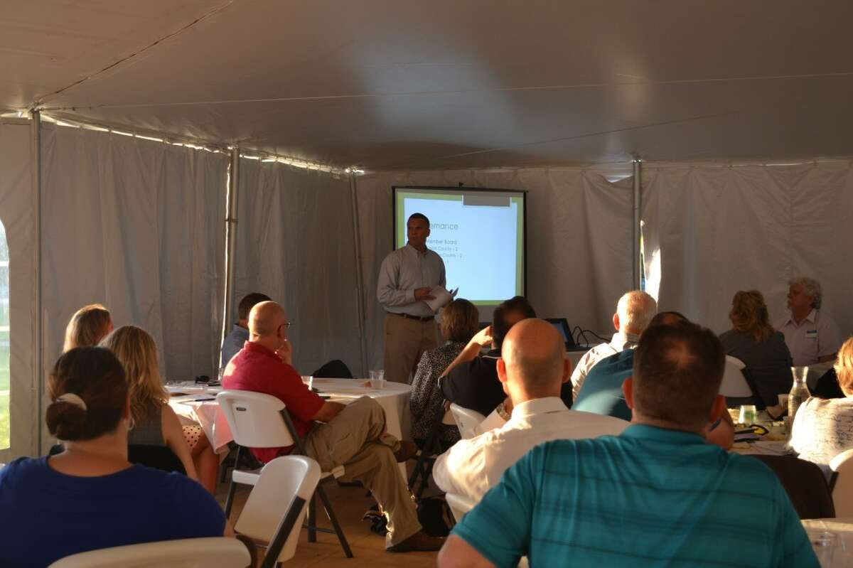 Jim Reithel, vice president of chemical operations at Martin Marrietta, presents a plan for regional economic cooperation on Wednesday under the tent at Manistee National Golf & Resort. (Meg LeDuc/News Advocate)