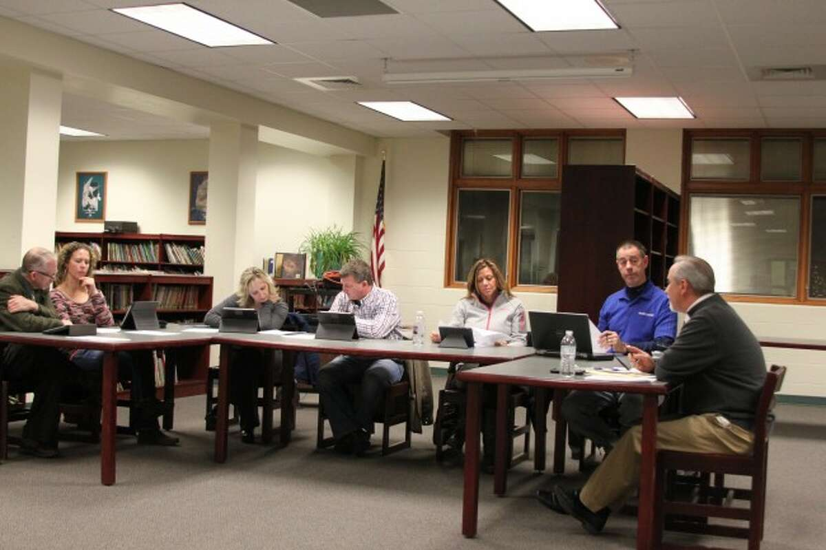 Bear Lake Board of Education members discuss a proposed roof project.