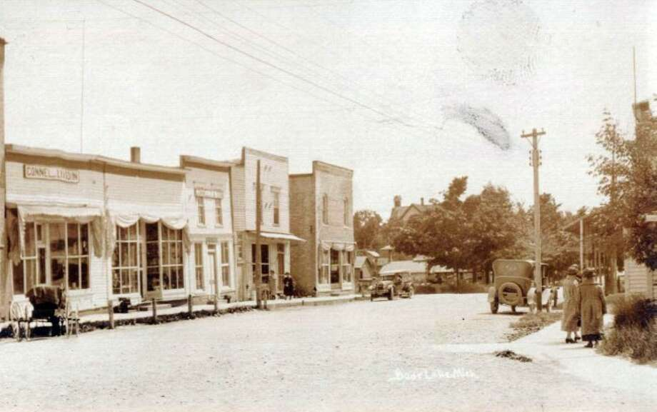 Main Street in the Village of Bear Lake was a busy place as shown in the 1920's photograph.