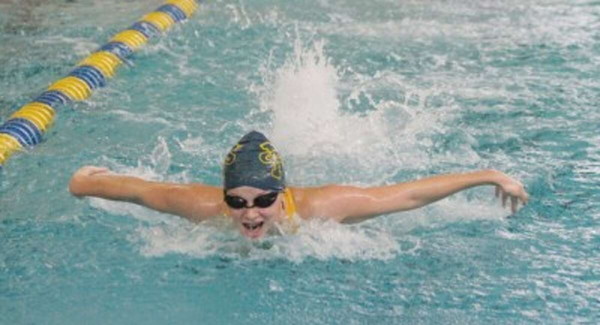 Manistee's Syriah Dobis swims the third leg of the 200-yard medley relay, which went on to qualify for the Division 3 state finals, during Thursday's meet against Fremont. (Matt Wenzel/News Advocate)