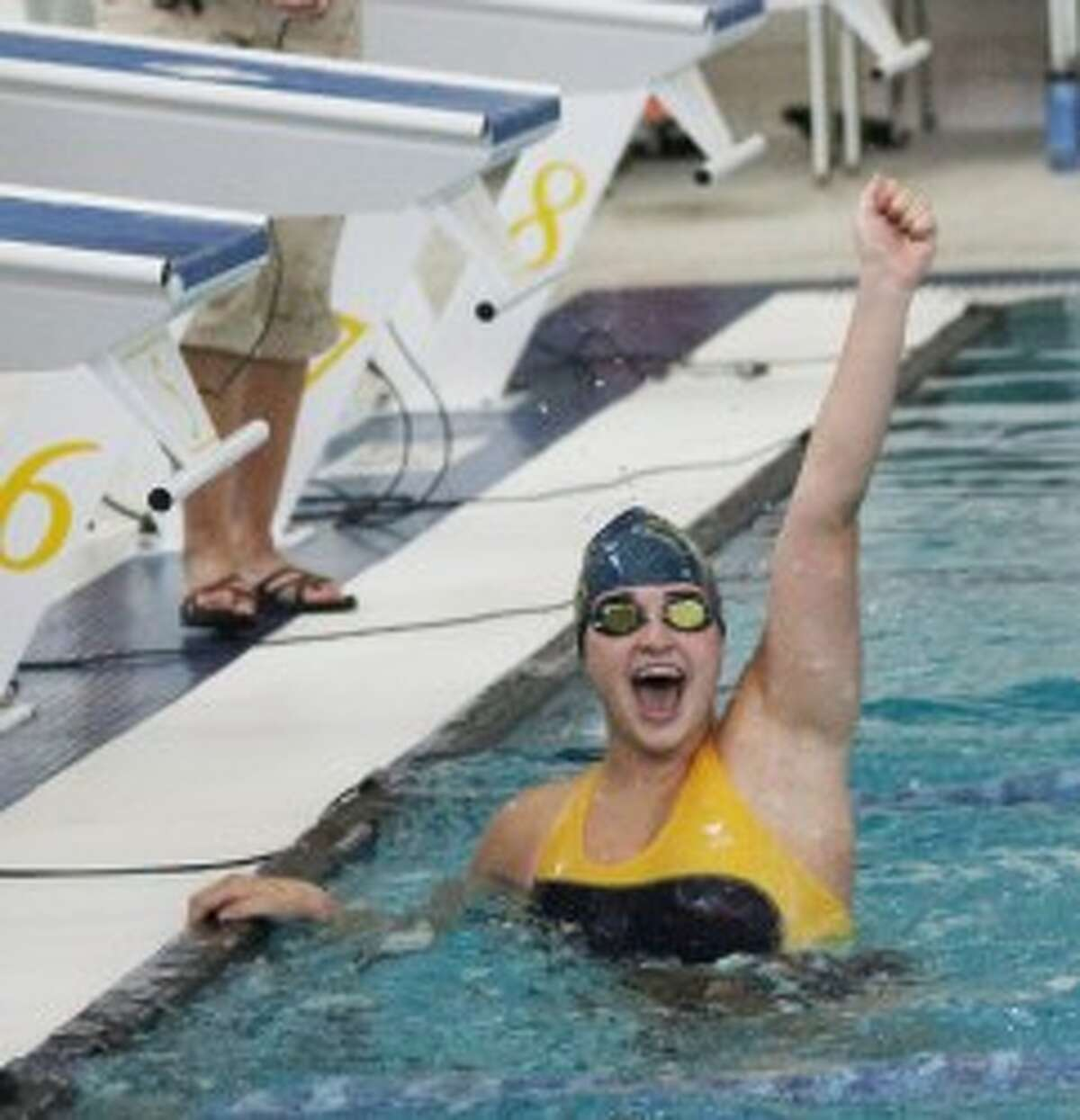 Sara Wehrmeister celebrates as the relay team's time is posted. (Matt Wenzel/News Advocate)