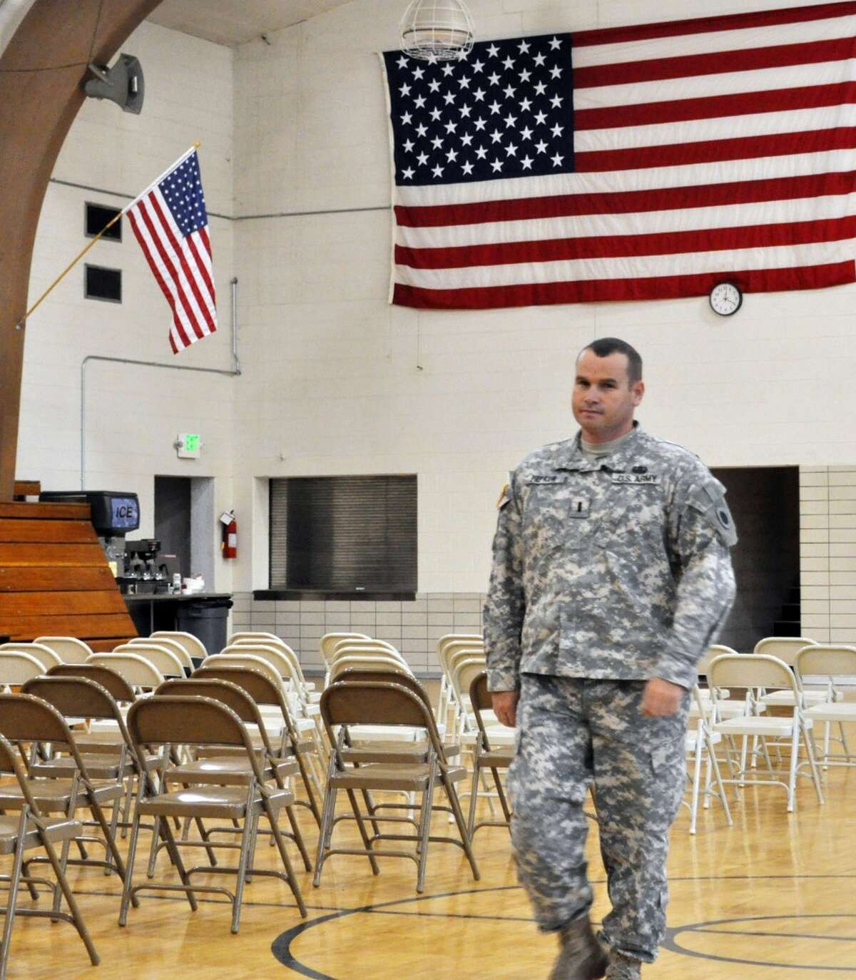 1st Lt. Thomas Piepkow, officer in charge of Bravo Troop's homecoming on Saturday, walks across the floor at the Manistee National Guard Armory Thursday afternoon making sure everything is in place for the 1 p.m. event. (Eric Sagonowsky/News Advocate)