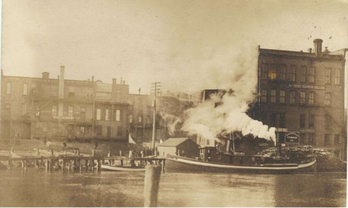 The Manistee Riverfront along the river channel is shown in this photograph from the 1890s.