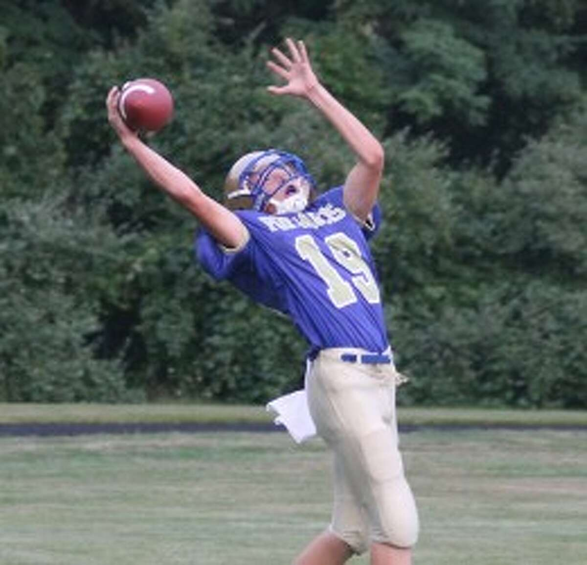 Onekama's Jarett Sovereign attempts to haul in a catch during a season-opening win against Hart. (Dylan Savela/News Advocate file photo)
