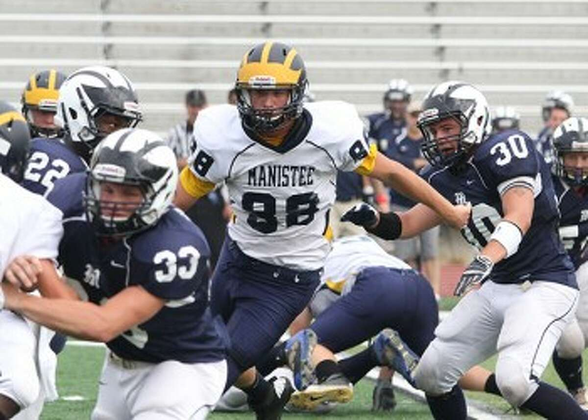 Manistee's Adam Ball pursues Mt. Morris running back Isaiah Collins during Saturday's loss at Alma College. The Chippewas travel to face No. 9 Lake City tonight. (Matt Wenzel/News Advocate)