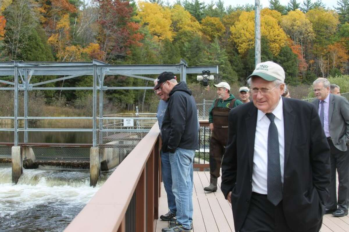 U.S. Sen. Carl Levin, D-Detroit, walks across the overlook platform at the Little Manistee River Weir during a tour of Manistee County in October 2014. (Photo by Justine McGuire/News Advocate)