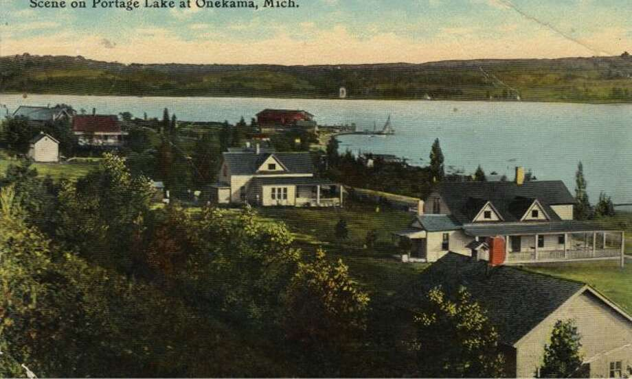 This early 1900 photograph shows a view of cottages on Portage Lake.
