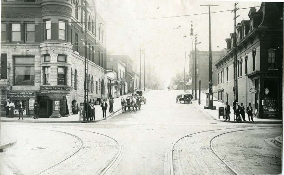 This very early 1900s view of the corner of River and Maple streets shows many of the local residents being intrigued by a photographer taking their picture.