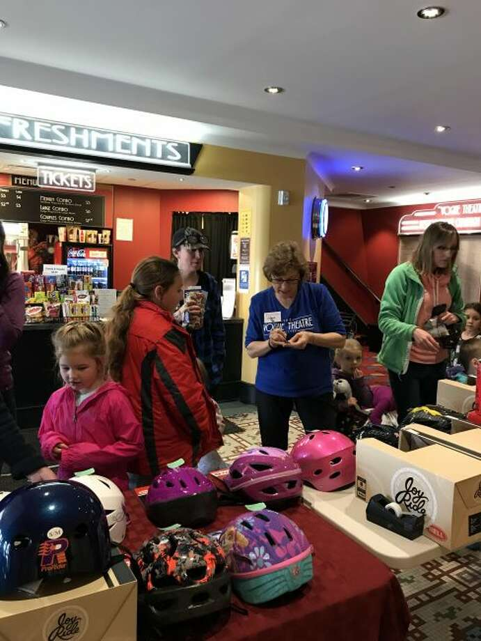 The Helmets for Kids program gave away 30 helmets at the Vogue Theatre on Saturday as part of the annual local initiative to keep children safe while riding their bicycles this summer. Organizer Clara Kahle said the program was a huge success this year.