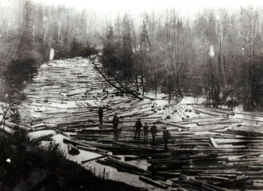 In the 1880s the best way to get the logs from out of the forests in Manistee County down to the sawmills in Manistee Lake was to hold log drives like the one shown in this photo.
