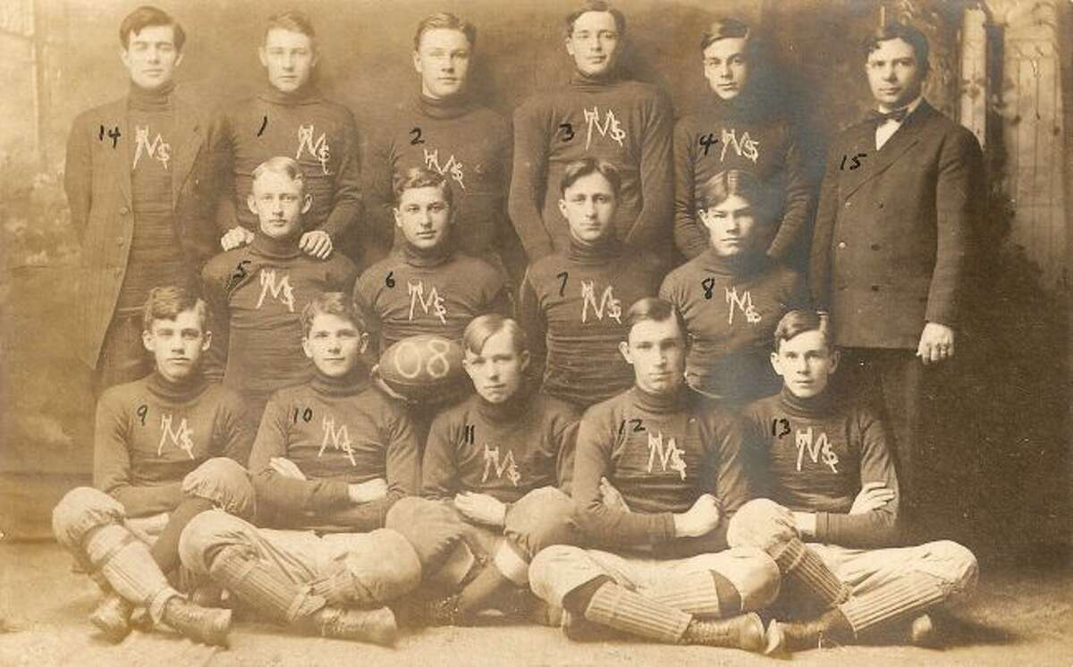 The 1908 Manistee High School football team is shown in this photograph along with the team's coaches.