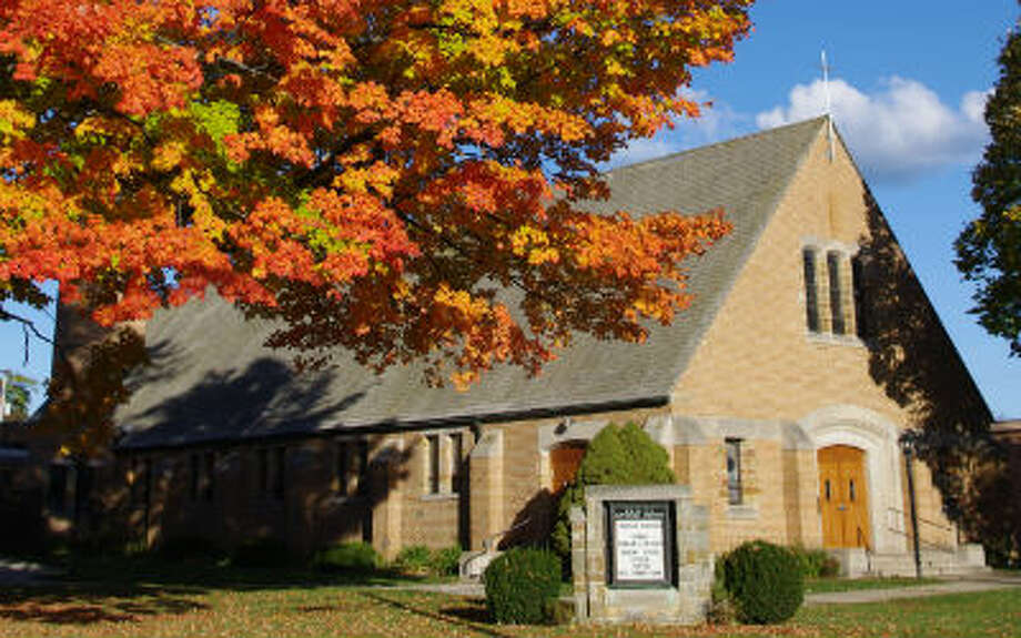 In front of Trinity Lutheran Church in Manistee the maple tree is ablaze with color. (Dave Yarnell)