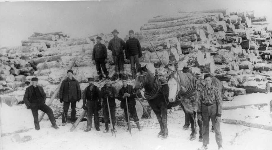 This hearty group of lumberjacks prepare to move another load of logs from the Manistee County woods to the mill for processing in the late 1890s.