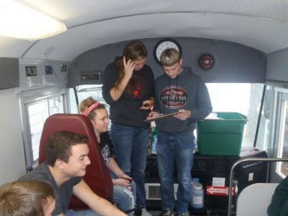 Donors line up at the front of the Michigan Blood bus to help with the Haunted Blood Drive held Oct. 26 at the Kmart Plaza in Manistee. (Courtesy Photo)