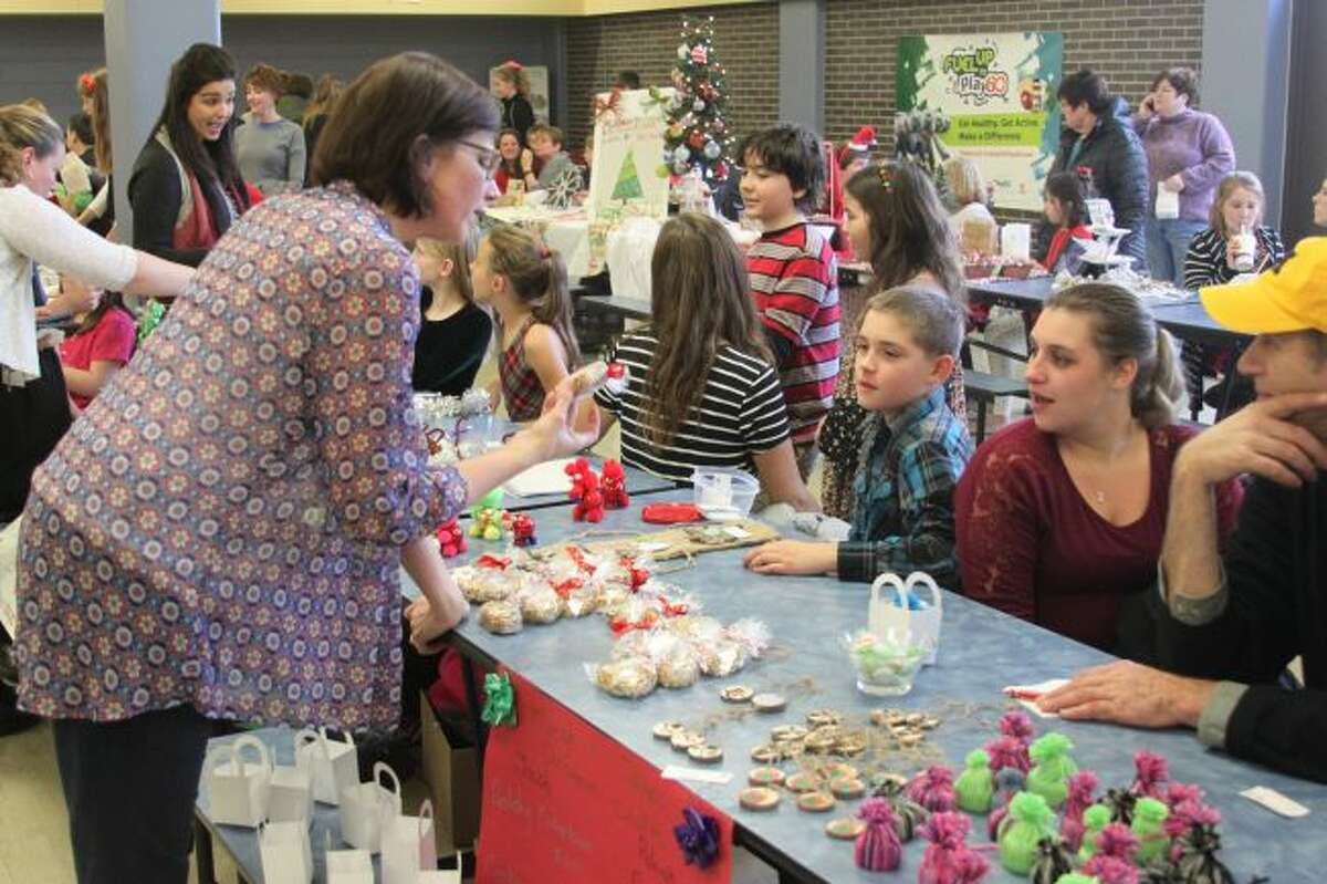Kennedy Elementary School students held their fifth annual Christmas Craft Show on Thursday at the school cafeteria. More than 50 students exhibited and sold crafts they created. The students were able to keep 70 percent of what they earned and 25 percent went to the Stomp Out Cancer campaign.