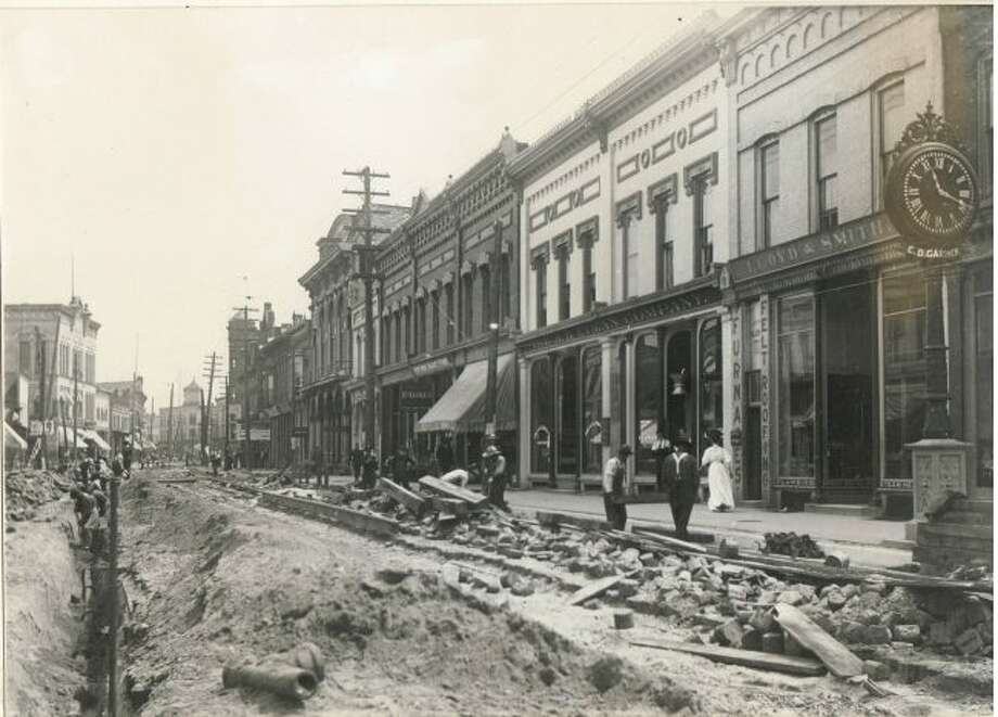 This 1900 photograph shows the River Street area being worked on in front of the current location of the Manistee County Historical Museum.
