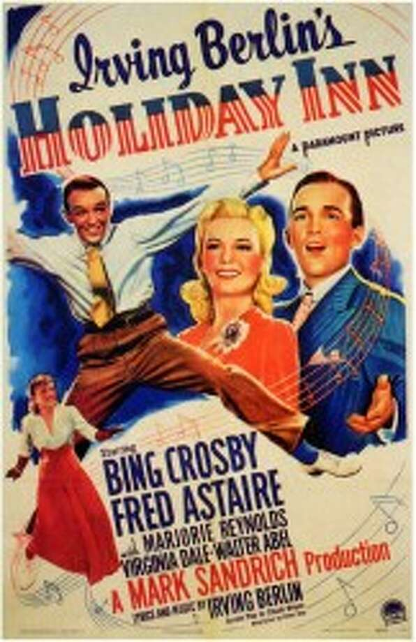 """This is the poster for the 1942 film """"Holiday Inn,"""" which starred Bing Crosby and Fred Astaire and featured the popular holiday song """"White Christmas."""" The movie played for three days at Manistee's Vogue Theatre, opening on Sept. 20, 1942. (Courtesy Photo/Manistee County Historical Museum)"""