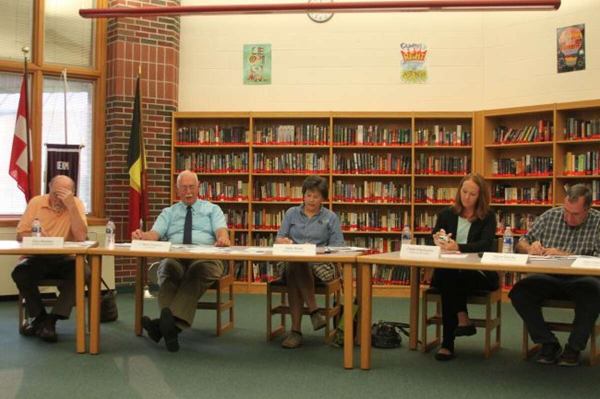 Onekama Consolidated Schools Board of Education and interim superintendent Mark Parsons (second from left) discussed the plans for the permanent superintendent search.