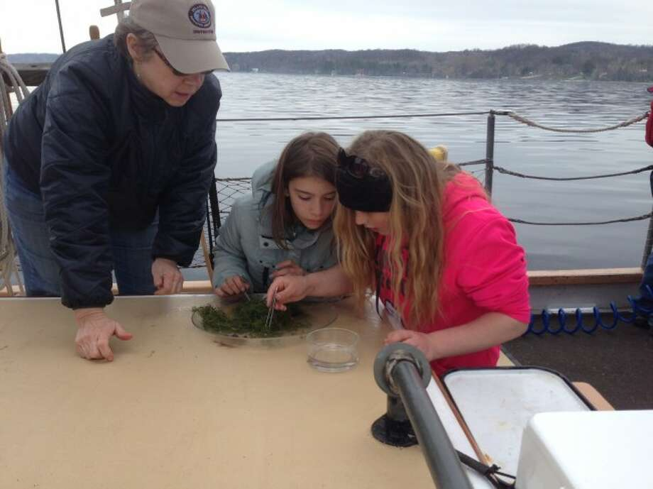 Students from Kennedy Elementary School work on experiments aboard the Inland Seas educational ships based in Traverse City and Suttons Bay.