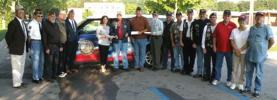 Several area veterans gathered this week to donate funds to the Manistee County D.A.V. veterans van program.