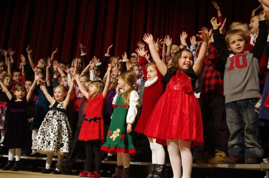 """Kindergarten students act out the song """"There was a Pig went out to Dig."""" (Dave Yarnell/News Advocate)"""