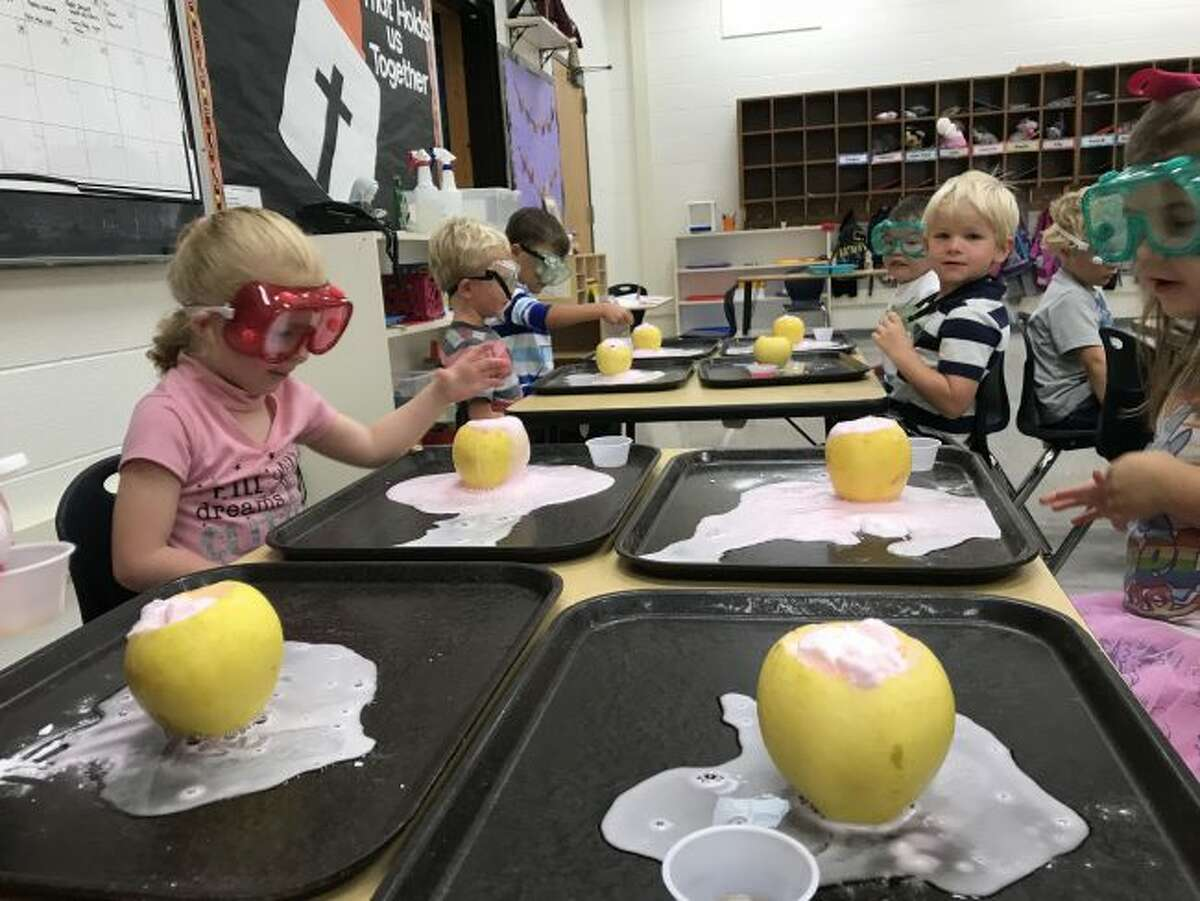 Manistee Catholic Central preschool students have fun with apple project to learn about science.