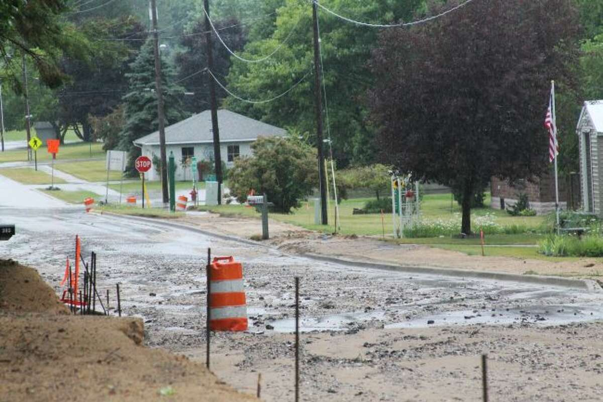 During a heavy rainstorm on Saturday, 12th Street in Manistee - which is under construction - was washed out, impacting various homeowners in the area. (Ashlyn Korienek/News Advocate)