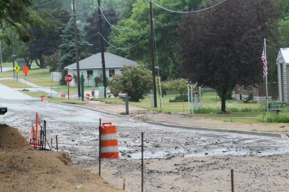 During a heavy rainstorm on Saturday, 12th Street in Manistee — which is under construction — was washed out, impacting various homeowners in the area. (Ashlyn Korienek/News Advocate)
