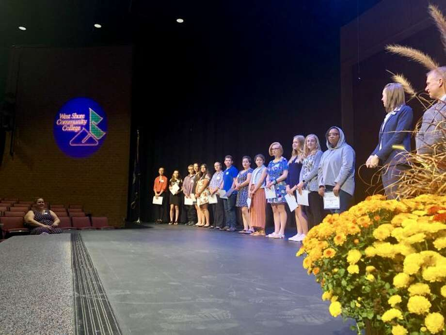 Students who were inducted into the Manistee County Community Foundation's Manistee Commitment Scholarship Program on Tuesday at West Shore Community College's Center Stage Theater. Students are shown proudly standing on the stage with their certificates.