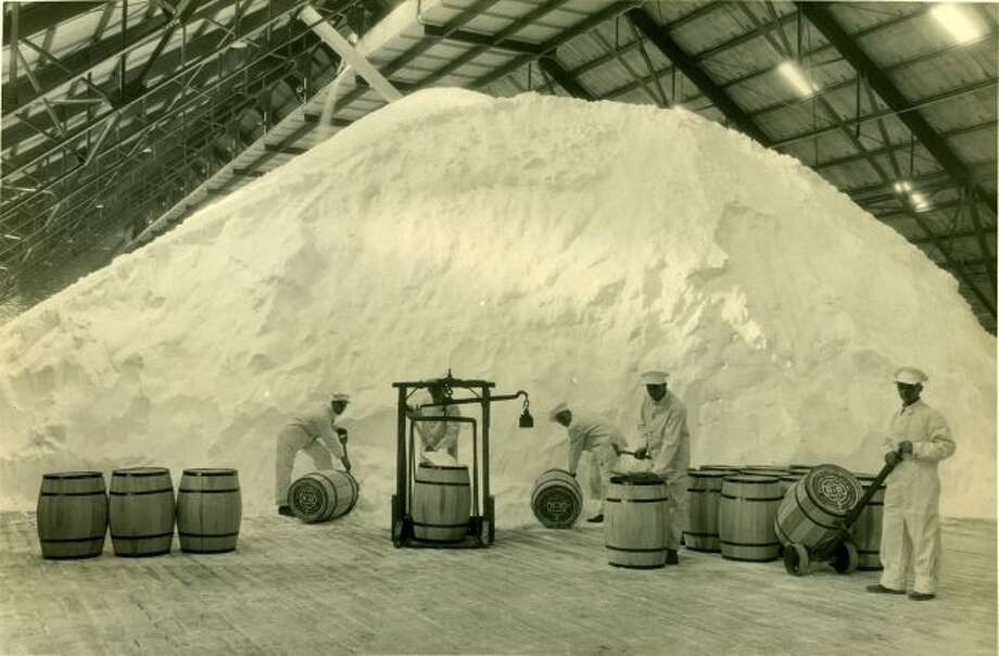 Workers at the Ruggles and Rademaker Salt plant file barrels of salt to ship out in this photo from the early 1900s.