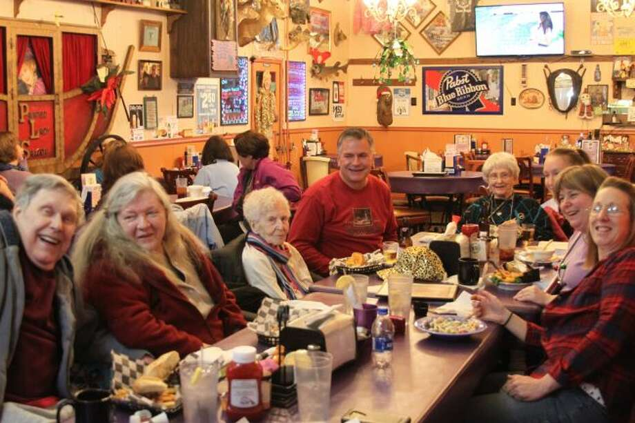Elva Palazzolo, pictured third from the left, celebrated her birthday surrounded by friends at the Painted Lady Saloon where she was the former owner. (Jane Bond/News Advocate)