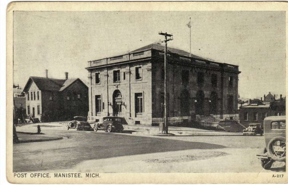 The Manistee Post Office building located on Maple Street that is the current home of the Manistee City Hall is shown in this photograph from the 1920s.
