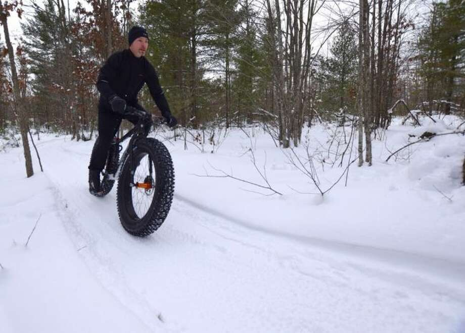 The riding of fat bikes in the snow on the trails at the M-55 Trail system is one of the many popular activities offered at that location.