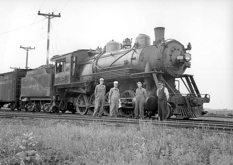 This crew from the Manistee and North Eastern Railroad proudly pose in front of their engine in this 1940 era photograph.