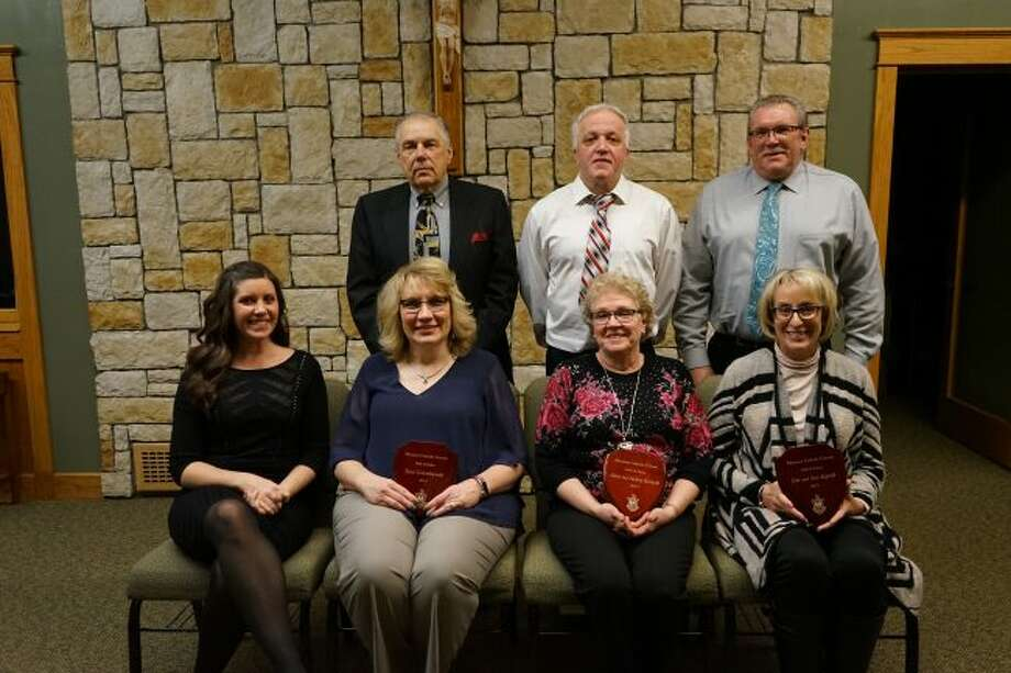 Pictured is (front row, left to right): Kelly Santorilla, Tana Golembiewski, Audrey Kostecki and Sue Espvik. Pictured (back row, left to right) is: Phil Kadzban, Steve Kostecki and Jim Espvik.The Gunia family is not pictured. (Ashlyn Korienek/News Advocate)