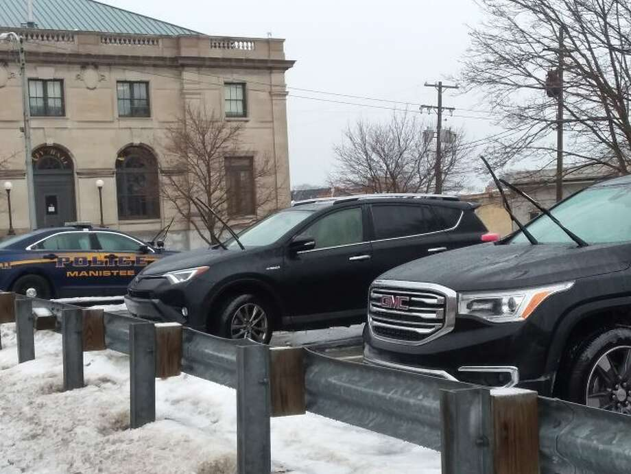 Many drivers in Manistee lifted up their windshield wipers to prevent them from freezing to their windshield on Thursday morning. (Michelle Graves/News Advocate)